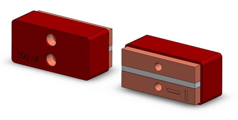 Front and rear view of an external capacitor for D5 Drivers